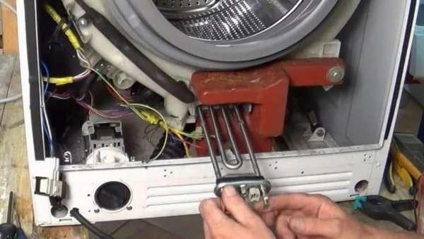 Извлечение тэна стиральной машины