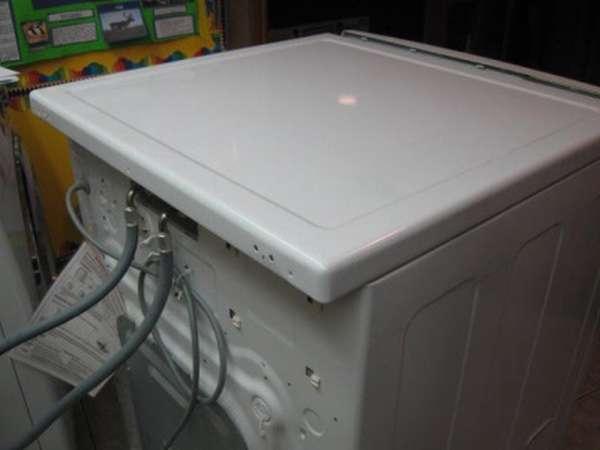 Как снять верхнюю крышку стиральной машины